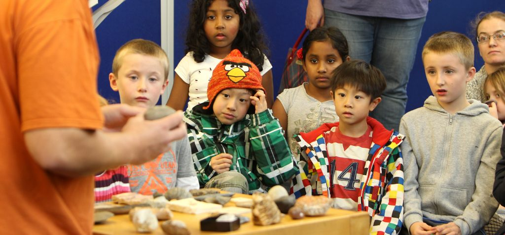 Pic: Tom Finnie (15.10.2015) Midlothian Science Festival - Dino Days at Dalkeith Library: Matt Dale, owner of Mr Wood's Fossils, explains about fossils and introduces his audience to dinosaur poo!