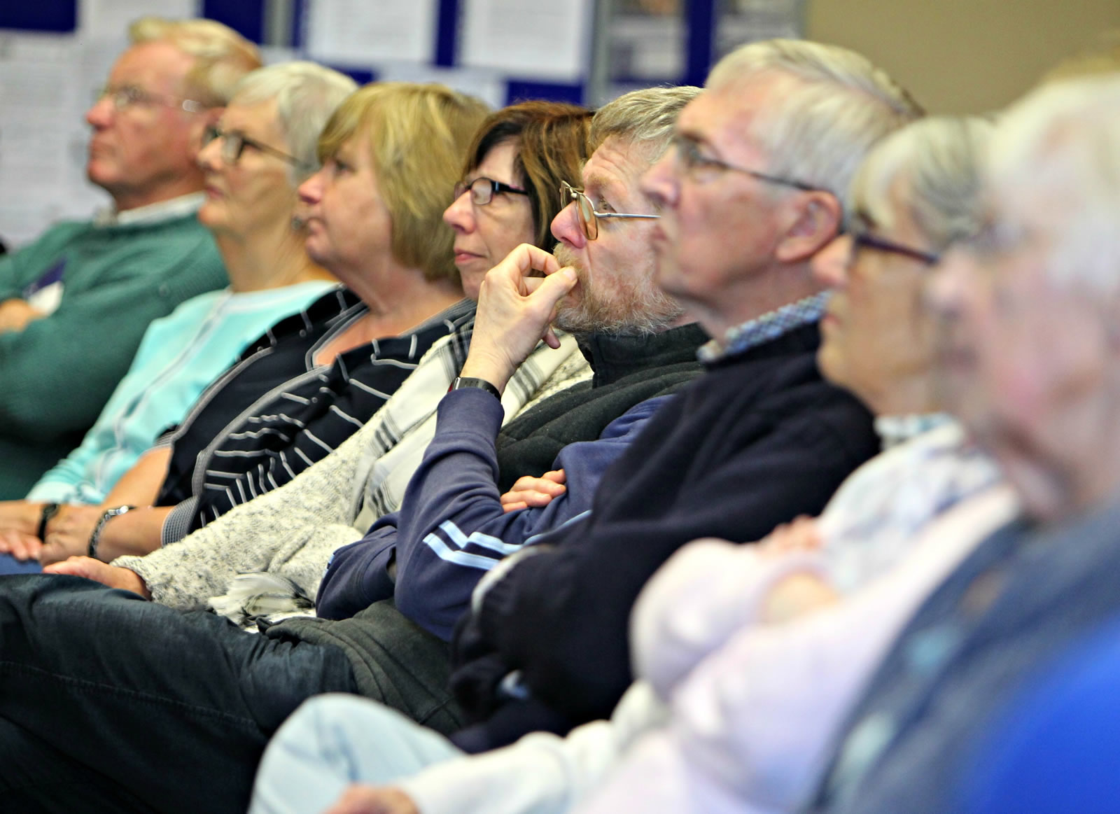 Adults in a row shown listening to a lecture by Jean Beggs at the U3A Penuicuik 2015