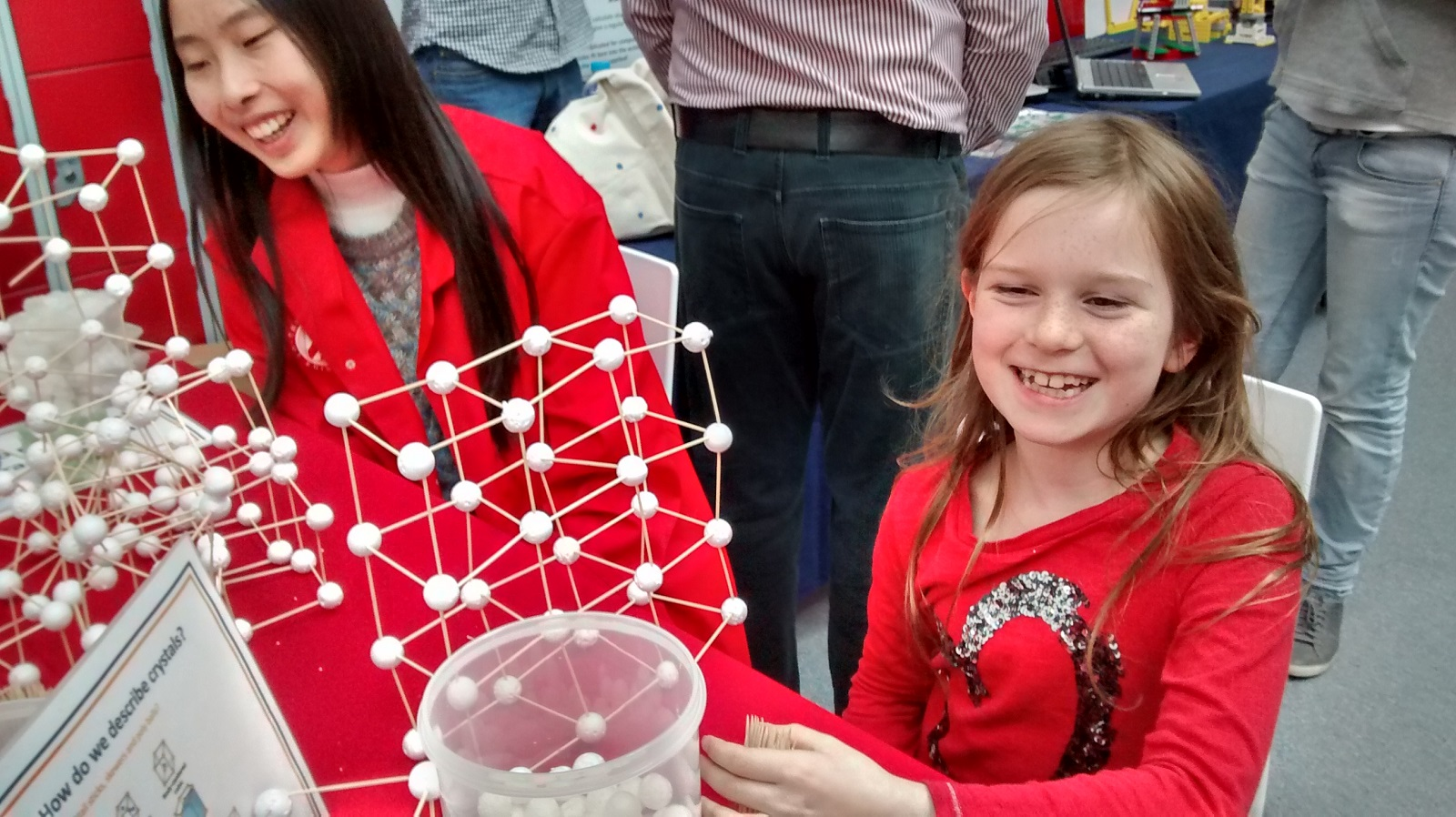 Photo of a girl with a molecule model