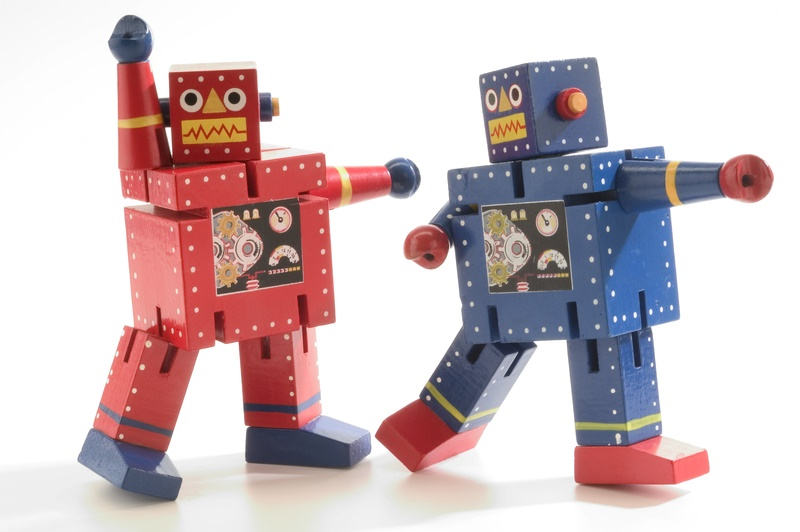 Two toy colourful dancing model robots.
