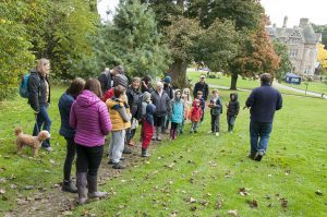 Adults and children walking in Vogrie Country Park